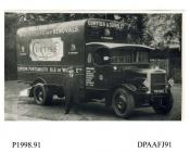 Photograph, black and white, showing a Asoociated Daimler lorry with driver, for Curtiss and Sons Limited, removals, London and Chatham, Kent, outside Radford Bridge Transport Cafe, London and Portsmouth Road, Liphook, Hampshire, 1930 - 32