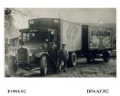 Photograph, black and white, showing a Berna lorry with trailer and driver, for St Julien, outside Radford Bridge Transport Cafe, London and Portsmouth Road, Liphook, Hampshire, 1930 - 32