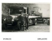 Photograph, black and white, showing a Saurer lorry with trailer and drivers, for E Wells and Son Limited, outside Radford Bridge Transport Cafe, London and Portsmouth Road, Liphook, Hampshire, 1930 - 32