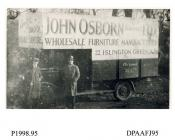 Photograph, black and white, showing a lorry with drivers, for John Osborne Limited, furniture mfr, 22 Islington Green, Islington, London, outside Radford Bridge Transport Cafe, London and Portsmouth Road, Liphook, Hampshire, 1930 - 32