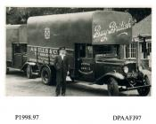 Photograph, black and white, showing a Bedford lorry with driver, for A Wells and Company, toy mfr, Somers Road, Walthamstow, London, outside Radford Bridge Transport Cafe, London and Portsmouth Road, Liphook, Hampshire, 1930 - 32