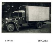 Photograph, black and white, showing a Pierce Arrow lorry with driver, for Palate Health and Purse, outside Radford Bridge Transport Cafe, London and Portsmouth Road, Liphook, Hampshire, 1930 - 32
