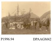 Photograph, sepia, showing a locals with a decorated horse drawn wagon, which won first prize at harvest festival, Hay Place Farm, Binsted, Hampshire, 1900-29
