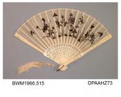 Fan, white gauze leaf embroidered in black with flowers and butterflies, shaped and pierced ivory sticks and guards, gilt loop with white silk cord, knotted, and two silk tassels, approximate radius 205mm, probably Japanese, early twentieth century