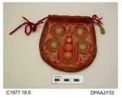 Bag, purse, small, brown wool embroidered with dense chainstitch design in red, yellow and pastel shades in the Indian style, maroon wool cord drawstring to opening, small yellow tassel attached to one side, lined red wool with internal pocket marked A.