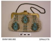 Bag, gilt snap-shut frame with matching chain handle, closely beaded all over, front having design of three pale blue ball shaped motifs fringed gold on fine gold strings against ivory background, back is entirely plain, lined watered ivory silk, approx
