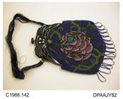 Bag, handbag, elaborate pierced black plastic frame with press knob closure, ribbon handle in black and navy blue, closely beaded all over in sombre shades of blue, olive, lilac, dusty pink and black, both sides having large flower with tendrils, front