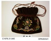 Bag, or reticule, dark brown velvet embroidered both sides in softly coloured silks and gilt thread, central bunch of mixed flowers framed by twined tendrils and flowers, lined cream silk, drawstring closure with mid brown satin ribbons, approximate wid