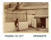 Photograph, the kennels of the harriers at Cahir Barracks, showing a man with a dog jumping up, taken by R Vervega, probably circa 1869vol 1, page 34 - Views of Cahir Barracks