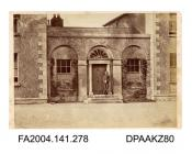 Photograph, an entrance to the officers' quarters at Clonmel Barracks with a soldier standing on the doorstep, probably taken by R Vervega, 1869vol 1, page 35