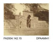 Photograph, the main entrance to the barracks at Clonmel with a soldier standing in the archway, possibly taken by R Vervega, 1869vol 2, page 19