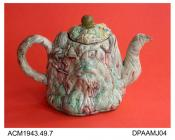 Teapot, chalky white earthenware, grotesquely modelled rock or tree stump shape in the manner of Jean Voyez, underglaze colours, knop on lid not original, not marked, possibly Staffordshire, c1770, or more likely a later imitation