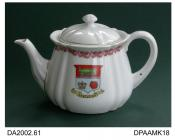 Teapot, hard paste porcelain, pear shape, transfer-printed rose border around rim and printed and enamelled arms of Eastleigh in Hampshire, not marked, made in one of the European countries formerly constituting Bohemia, c1890