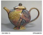 Teapot, stoneware, globular shape with wide strap handle, base marked with decorator's initials, decorated by Robyn Clark at the Grayshott Pottery, School Road, Grayshott, Surrey, to a design by Janice Tchalenko, made in 1998
