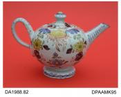 Teapot, tin-glazed earthenware, delftware, globular shape, footed, decorated with a floral design in colours, not marked, made in London, c1760