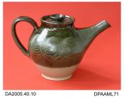 Teapot, buff stoneware, inverted pear shape, upper two-thirds dipped in green-brown mottled glaze with combed decoration, not marked, made by Tim Naylor, Brockweir, Gloucestershire, c1975-1985the glaze is said to incorporate sediment from the River Wye