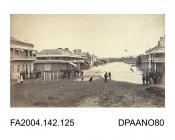 Photograph, the floods in the main street of Wagga Wagga, with people and dogs looking on. The Australian Joint Stock Bank is on the left. 1870.vol 2, page 127
