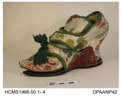Shoes, pair, women's, brocaded cream satin with a floral pattern in shades of pink, green and yellow over white kid, all edges and seams covered with green silk ribbon, dog-leg side seams, needlepointed toe, high square tongue lined pale yellow cotton,