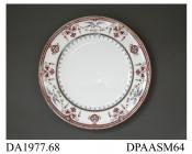 Dinner plate, white earthenware, black printed 'Berlin Bird' design overpainted in red enamel and straw-colour lustre; back, red painted pattern number, impressed factory marks including letter T, BB (for Best Body) and date symbol for 1870 and printed