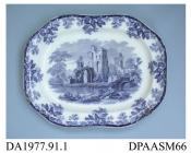 Meat dish, white earthenware, decorated with one of a group of flow blue printed designs showing a ruined lakeside castle within a border of oak leaves and acorns; back, impressed crown, printed factory mark in green and printed registered design mark i