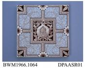Tile, pressed clay dust, printed with scrolling foliage reserved in white on a blue ground and a pomegranate similarly shown in white on a solid sepia cartouche in centre; back, moulded ridges and factory marks and printed registered design mark with en