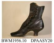 Skating boot, one only, women's, grained black leather, side buttoned with twelve buttons, now missing, scalloped edge to apron, curved and shaped top edge, oval toe, curved and waisted high wooden heel with central hole, wooden sole with sturdy metal r