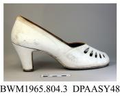 Shoes, pair, women's, white buckskin, rounded open toe, vamp decorated with tear-drop shaped cut-outs and fine stitching, high straight Louis heel, leather sole, grey leather insole printed Norvic, approximate length overall 230mm, approximate heel heig