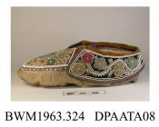 Slippers, pair, women's, moccasin style, chamois leather, lined coarse cream cotton, apron trimmed brown velvet edged purple ribbon binding, thickly beaded in stylized floral design of multi coloured beadwork, brown velvet of apron extends to form tongu