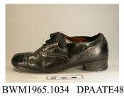 Shoes, pair, child's, black leather, front laced with four pairs of eyelets and wide black laces over full length tongue, galosh with toecap and punched detail, lined brown kid, squared toe, insole printed The Hansit, stacked leather heel with repair, l