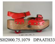 Shoes, pair, women's, Pop Wheels Roller Skates, red leather strap over forefoot with buckle closure, red leather ankle strap with buckle closure, brown synthetic platform sole with retractable red roller skates, label CNTM Diffusion, Made in Italy, blac