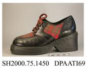 Shoes, pair, women's, decorated in the Bay City Rollers style, black synthetic material trimmed tartan fabric, laced with four pairs of eyelets and colourful braided laces over a full length tartan tongue, one lace is missing and has been replaced with