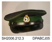 Cap, British military issue peaked cap, Dental Corps officer's dress uniform, stiffened navy woollen broadcloth with emerald green piping and hatband,  black plastic peak to front and black plastic strap trim above, front having cap badge with Queen's c