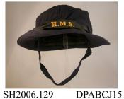 Hat, WRENS soft gabardine hat, black silk ribbon cap talley printed HMS, navy blue gabardine, soft crown in six sections, wide brim with stiffening and topstiched detail, lined with black cotton, navy wool braid chinstrap secured on right with two small