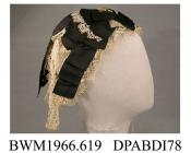 Cap, day cap, women's, Fanchon style,  Bedfordshire Maltese lace and black corded silk ribbon on a triangular base of black net, the cap is arranged as a graduated series of bows and lace frills from the brow over the crown, two long streamers of lace a