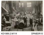Photograph, black and white, showing workmen in the old smithy boiler shop, Tasker and Co, Waterloo Foundry, Anna Valley, Abbotts Ann, Hampshire, 1880-1910