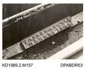 Photograph, black and white, showing a nameplate, Tasker and Fowle on Enford Bridge, Enford, Hampshire, built by Tasker and Co, Waterloo Foundry, Anna Valley, Abbotts Ann, Hampshire, taken 1960