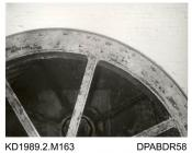 Photograph, black and white, showing a mill wheel, Tasker and Co's name cast on wheel, Enford Mill, Enford, Hampshire