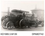 Photograph, black and white, showing three men with a steam engine and box trailer, built by Tasker and Co, Waterloo Foundry, Anna Valley, Abbotts Ann, Hampshire