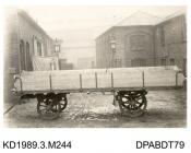 Photograph, black and white, showing a 4 wheel trailer, built by Tasker and Co, Waterloo Foundry, Anna Valley, Abbotts Ann, Hampshire