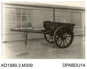 Photograph, black and white, showing a plank side farm cart, built by Tasker and Co, Waterloo Foundry, Anna Valley, Abbotts Ann, Hampshire