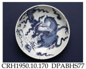 Dish, hard paste porcelain, decorated in underglaze blue with four-clawed dragon and flaming pearls, subject extends from the inside to the outside of the bowl; untranslated seal mark on base, made in Jingdezhen, Jiangxi Province, China, c.1750