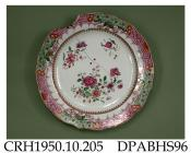 Plate, hard paste porcelain, pointed ogee rim, decorated in famille rose colours and gilt with pink scale and prunus blossom border and central sprigs; not marked, made in Jingdezhen, Jiangxi Province, probably decorated in Guangzhou, Guangdong Province