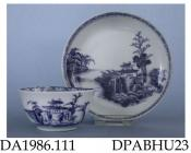 Tea bowl and saucer, hard paste porcelain, decorated with cobalt blue Pagoda, trees and rocks and diaper border, made in Jingdezhen, Jiangxi Province, China, c1751 the tea bowl and saucer were among more than 150,000 porcelain items salvaged in 1985-86