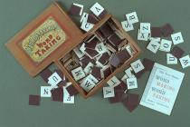 Word game, Word Making and Word Taking, square pieces with a black printed letter of the alphabet on each, with instructions for play, in wooden box with sliding lid, late 19th early 20th century?