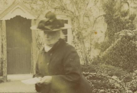 Charlotte Yonge in her garden in later life