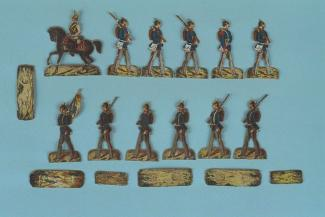 Toy soldier, 12 paper soldiers in German uniforms, consisting of 10 marching soldiers, 1 flag bearer and a cavalryman, with stands, c1870s