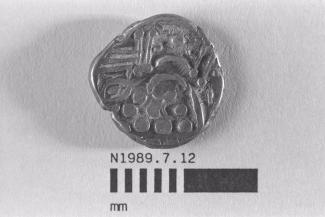 Coin, stater, part of a hoard found by a metal detector at Ironshill, Lyndhurst, Hampshire, issued 1st century BC