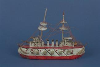 Model ship, papier mache ship with wooden masts and string rigging, hull and deck painted red with black and gold detail, with 3 funnels, early 20th century?