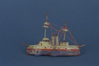 Model ship, papier mache ship with metal masts and string rigging, hull painted red and blue with black and gold detail, with 2 funnels, early 20th century?