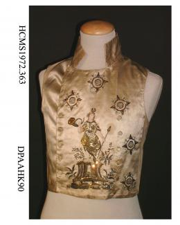 Waistcoat, man's evening wear, ivory silk satin with applique of goddess Diana, c1800s natural linen back and lining; metal thread embroidery and spangles and paper applique of Diana on main body; 8 buttons one side and 7 on other; double breasted; stan